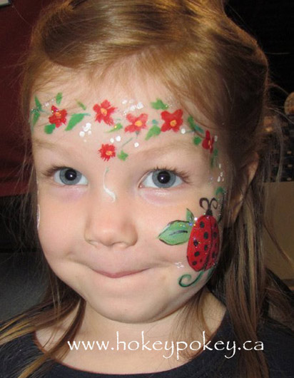 Lady bug on a cheek face paint